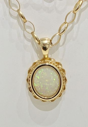 Oval Opal Yellow Gold Necklace With A Roped Edge